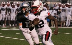 Junior quarterback Matthew Williams runs past senior safety Sean King. The Sandy Creek offense dominated, accumulating 555 total yards against Starr's Mill.
