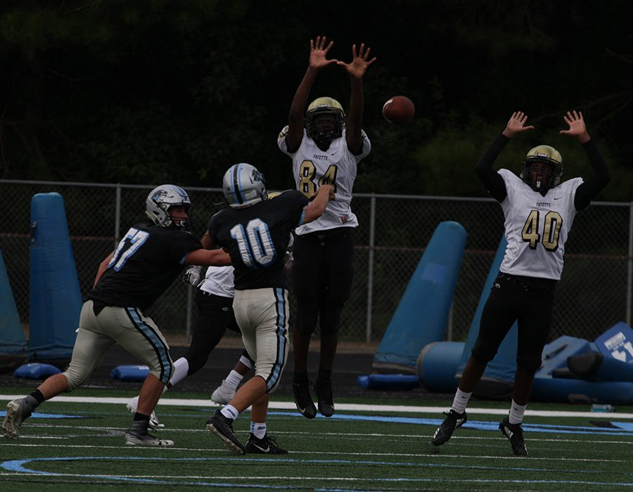 Freshman+Colin+Bartek+looks+to+pass+against+Fayette+County.+Despite+struggling+to+pass+a+week+ago%2C+Bartek+did+well+against+the+Chiefs%2C+firing+one+of+his+three+touchdowns+on+the+day+into+the+end+zone+in+the+win.+Bartek+also+added+two+rushing+touchdowns.