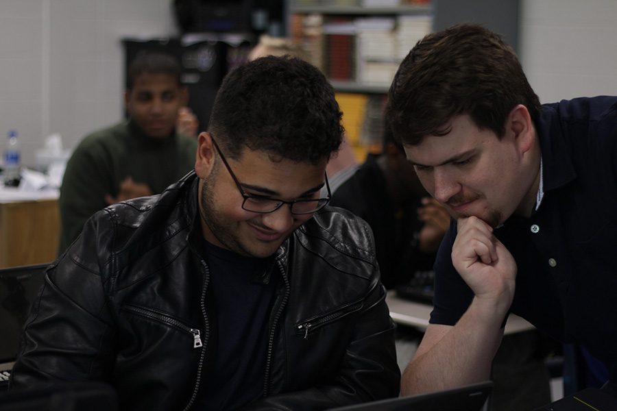 "Terrence Fitzgerald (right) helps a student on an English assignment. ""If my students don't leave my English class feeling tired, I'm not doing something right,"" Fitzgerald said."