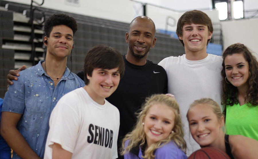Gibbons (middle) poses with students from a team sports class.