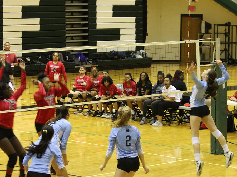 Senior Kaylee Leachman prepares to spike the ball against Jonesboro. The Panthers were able to score without difficulty in round one. Starr's Mill beat the Cardinals in two games, with scores of 25-5 and 25-2.
