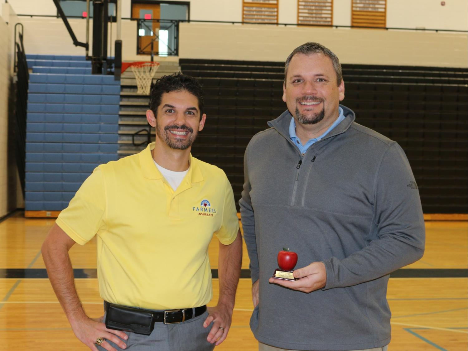 Tim Monihan from Farmers Insurance in Peachtree City poses with this month's Golden Apple winner Jason Flowers. Flowers was selected for this award because of his personable  teaching style, which helps him relate to his students.