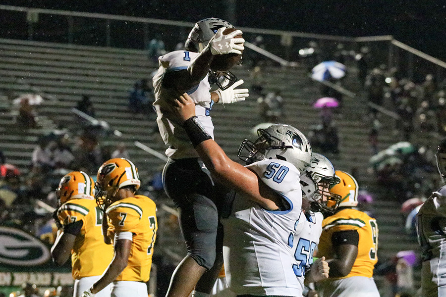 Junior Jeff Tiller raises up junior Kalen Sims as the two celebrate a touchdown. Sims rushed for 145 yards and two touchdowns against the Bears. He now has 842 yards and nine touchdowns on the season.