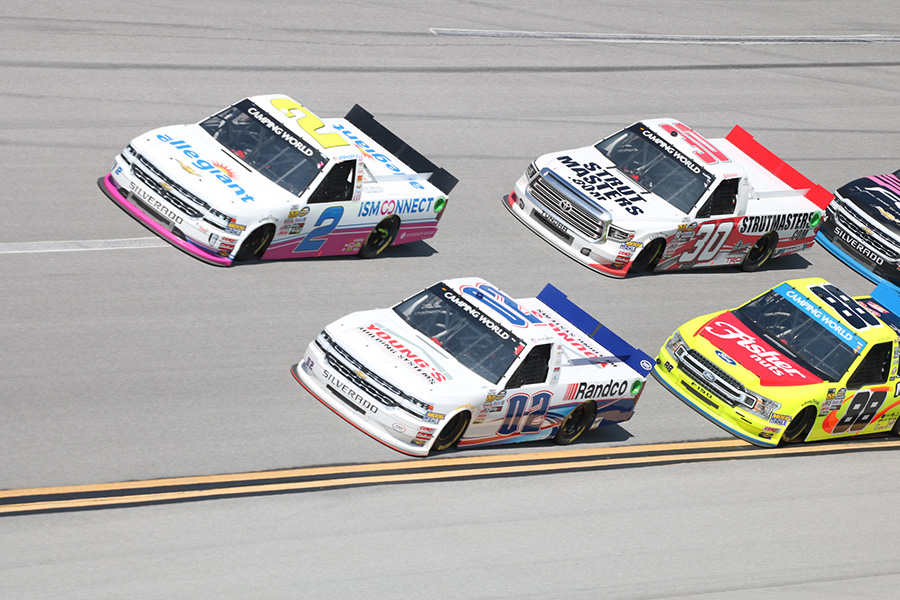 "Austin Hill, driver of No.02  Young's Building Systems/Randco Chevrolet, races near the front of the pack early in the Fr8Auctions 250. At Talladega, restrictor plates are added to the engines to level the playing field, which allows smaller teams to have a chance to win the race. ""Since everyone's drafting, everyone's running restrictor plates, it equalizes the field, and it's really anybody's race,"" Hill said."