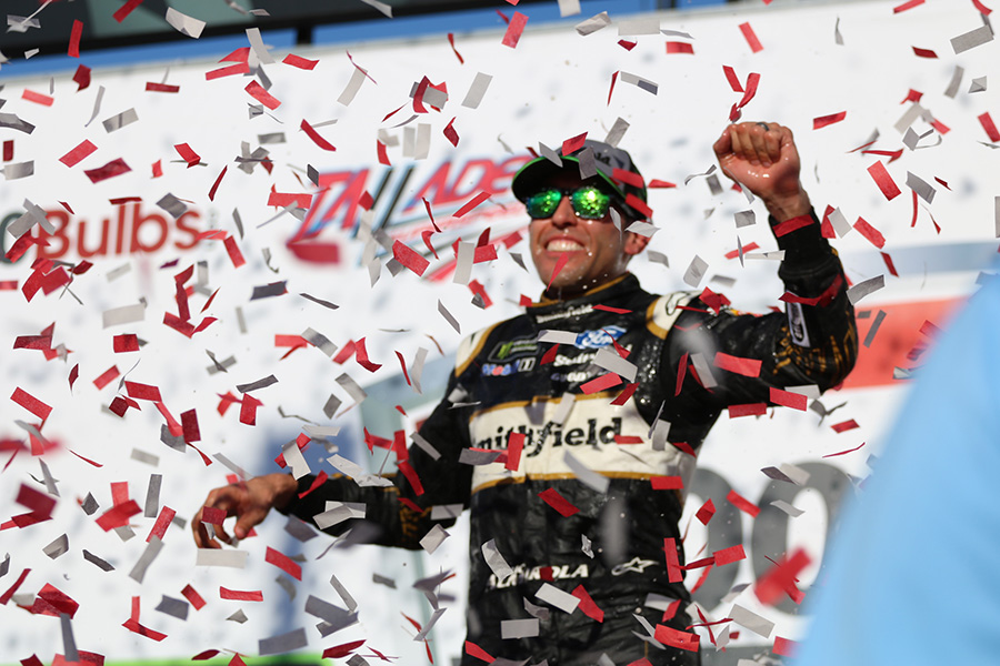 Aric Almirola, driver of the No. 10 Smithfield Bacon For Life Ford for Stewart-Haas Racing, celebrates in Victory Lane after winning 1000Bulbs.com 500 at Talladega Superspeedway. Almirola stayed up front with his teammates all race and was in position to take the lead on the final lap and earn his first victory with Stewart-Haas Racing.