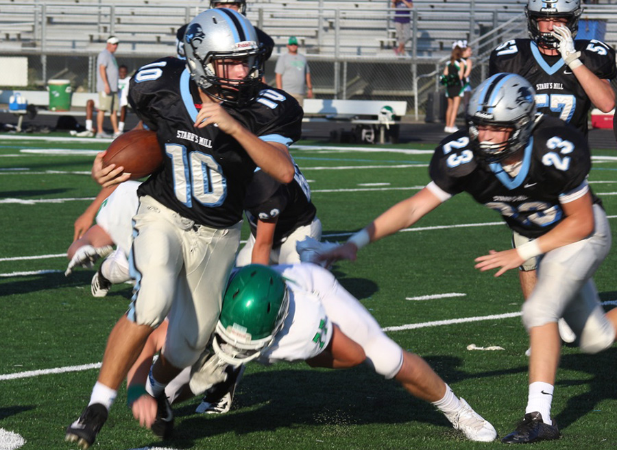 Freshman quarterback Colin Bartek breaks away from a Chief blitz. Bartek ended the game with two touchdowns and 117 total yards.