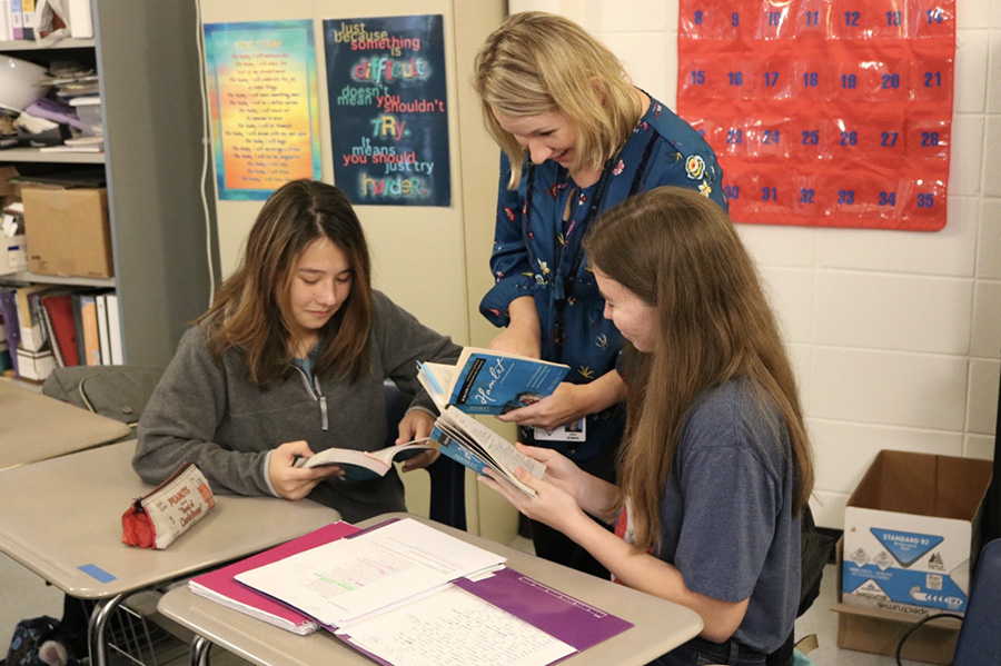 "English teacher Jillian Bowen reading ""Hamlet"" alongside her students. Bowen was nominated as teacher of the year for Starr's Mill and will compete in county teacher of the year in April."
