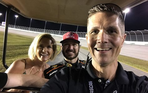 Director of Racing Communications Matt Humphrey carts Monster Energy NASCAR Cup Series driver Martin Truex Jr. and girlfriend Sherry Pollex around the race track. In being in charge of at-track communications, Humphrey will spend time with the drivers, as well as the journalists to ensure that everything gets done as it should.