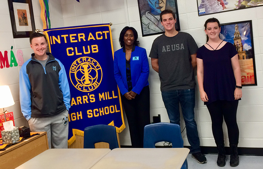 Interact Club Guest Speaker Darlene Drew poses with the Interact Club President Caleb Warnock, and club members Ashley Osborne and Thomas Cummings. Drew led the meeting with a speech about making choices, and personal anecdotes of her job as a warden.