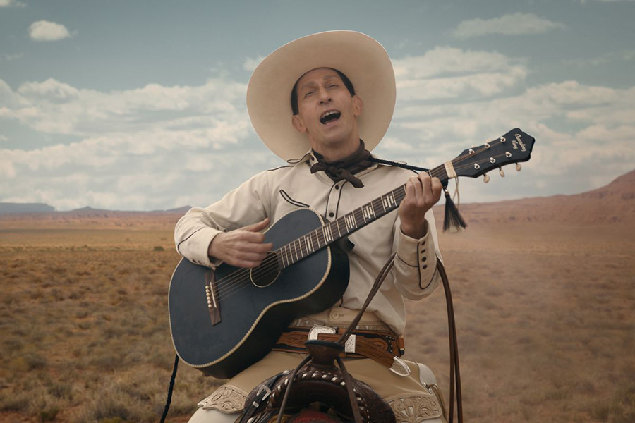 "Eccentric cowboy Buster Scruggs rides through the desert, singing a tune on horseback. Scruggs' story is one of six in the anthology western film ""The Ballad of Buster Scruggs,"" a magnificent portrayal of the Old West created by the Coen Brothers."