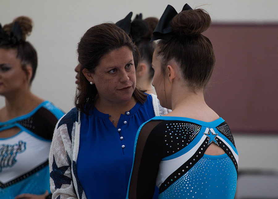 "Head coach Heather McNally talks with senior Hannah Defler at the competition held at Whitewater High School where the Lady Panthers placed first.  ""Definitely the best experience was hitting our routine at Whitewater because we got our confidence in, and it's helped us throughout the the season,"" Defler said."