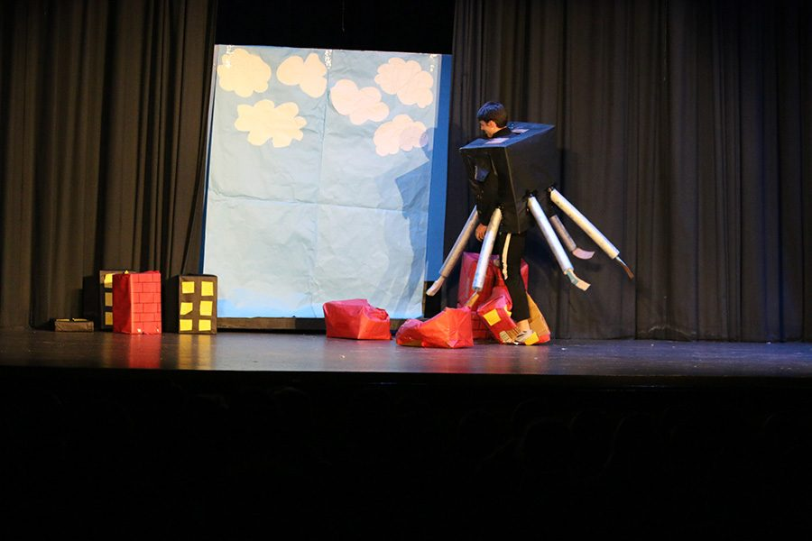 """Senior Luke Presley dressed as the robot from """"The Incredibles"""" destroys a city of cardboard boxes to fill his role in this year's foreign language plays. It's a tradition at Starr's Mill for fourth-year language students to put on plays for their fellow classmates and this year brought about four successful and hilarious performances."""