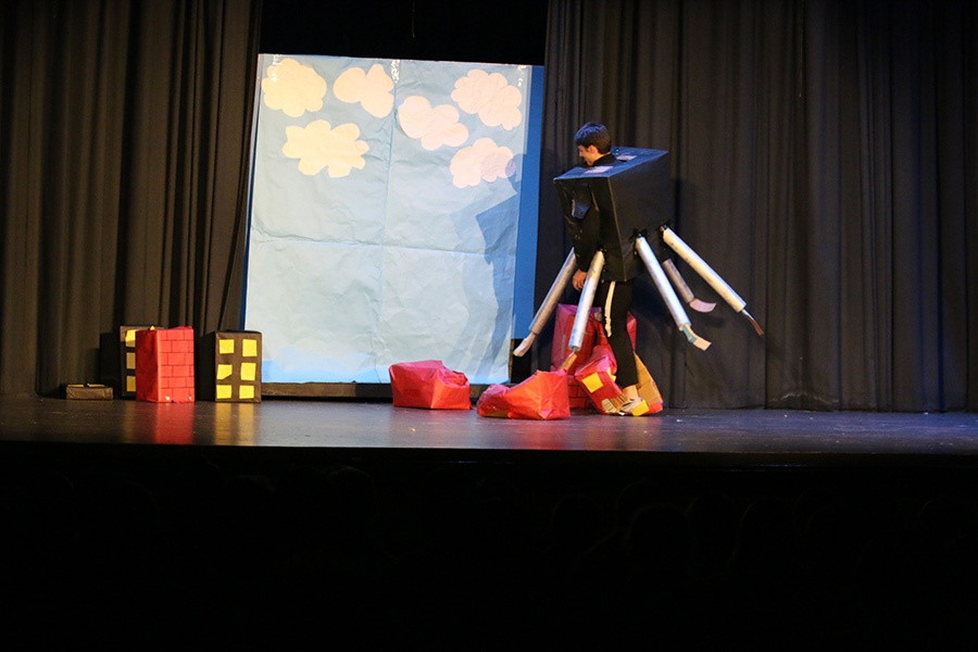 "Senior Luke Presley dressed as the robot from ""The Incredibles"" destroys a city of cardboard boxes to fill his role in this year's foreign language plays. It's a tradition at Starr's Mill for fourth-year language students to put on plays for their fellow classmates and this year brought about four successful and hilarious performances."