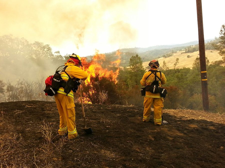 Firefighters work to put a fire during a blaze in northern California. Inmates who sign up to work alongside employed firefighters deserve equal treatment and a proper minimum wage.