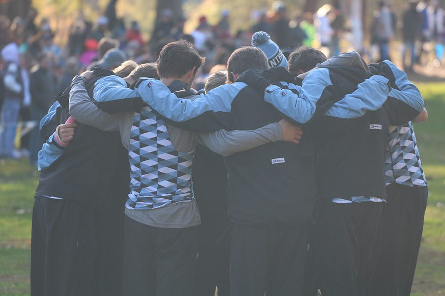 The Starr's Mill cross country team huddles before the Meet of Champions. The team was invited to the meet one week after winning the GHSA State Championship.