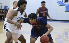 Junior Panther Jamaine Mann defends senior Patriot T.J. Bickerstaff. Mann, ranked 97th in the nation in the class of 2020 according to 247sports.com, scored 25 points while going head-to-head with Bickerstaff, who is a Drexel commit and nephew of NBA head coach J.B. Bickerstaff.