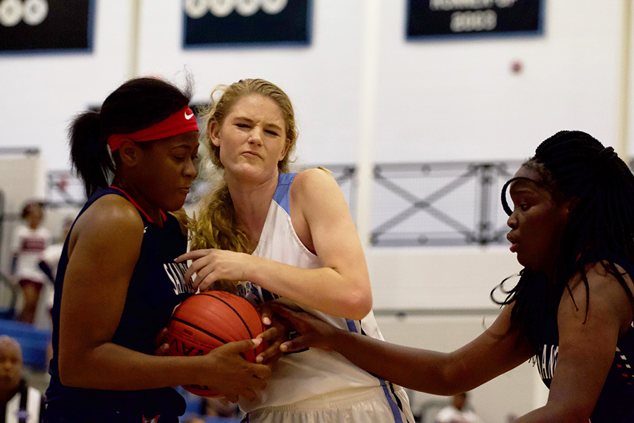 Freshman Panther Jaclyn Hester fights for possession. Hester scored 13 points and junior Alice Anne Hudson added 16, but the Lady Panthers still fell to Sandy Creek 48-45.
