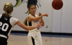 Sophomore Lauren Flanders passes the ball to a nearby teammate. The JV Lady Panthers took the win over the Lady Chiefs 32-13 despite many turnovers from both teams. However, the Starr's Mill defense was enough to keep McIntosh off its game.