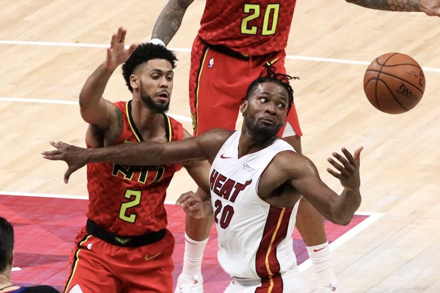 Atlanta Hawks guard Tyler Dorsey defends Miami Heat guard Justise Winslow. Dorsey was scoreless against Miami, but he put up two assists and a steal. Winslow totaled 13 points, five rebounds, and three assists in the 106-82 loss to Atlanta.