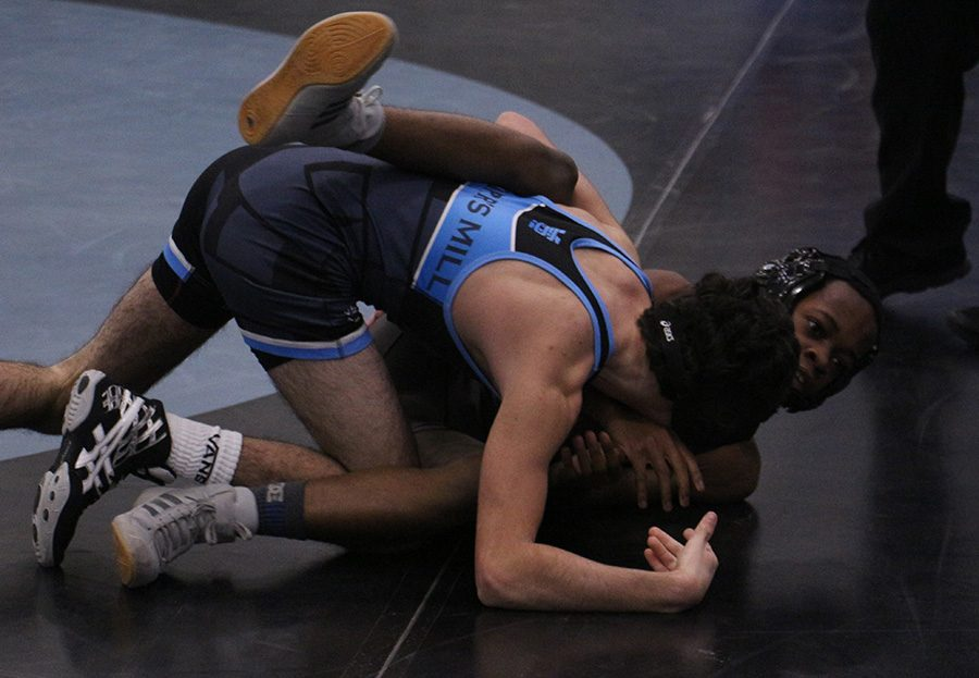 """Freshman Nick Ferraro struggles for position against a Jonesboro opponent. Ferraro, in the first match of the day, got the Panthers started on their shutout win. """"We're looking for [the younger guys] to do their jobs,"""" head coach Andrew Garner said. """"Whether that is to get a win, get a pin, or if they don't win, to not get pinned."""""""