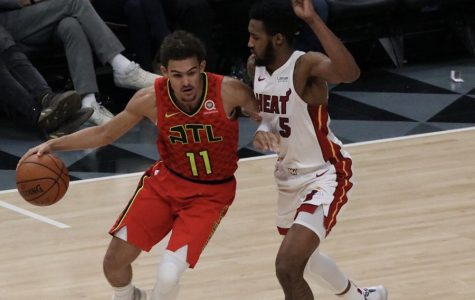 Miami Heat forward Derrick Jones Jr. defends against Atlanta Hawks rookie guard Trae Young.  The two led their respective teams in scoring. Young led the Hawks with 19 points, and Jones contributed 14 for the Heat. The 106-82 win was the third time this season the Hawks defeated the Heat.