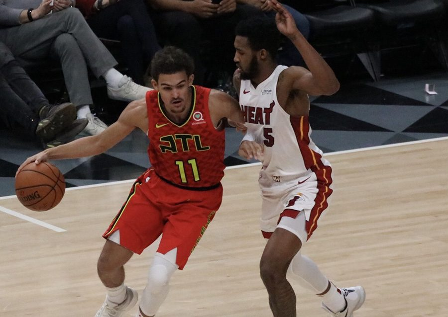Miami+Heat+forward+Derrick+Jones+Jr.+defends+against+Atlanta+Hawks+rookie+guard+Trae+Young.++The+two+led+their+respective+teams+in+scoring.+Young+led+the+Hawks+with+19+points%2C+and+Jones+contributed+14+for+the+Heat.+The+106-82+win+was+the+third+time+this+season+the+Hawks+defeated+the+Heat.