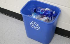 Recyclable items fill a blue recycling bin. The ecology club is bringing back recycling bins to every teacher's classroom after two years without the opportunity to recycle.