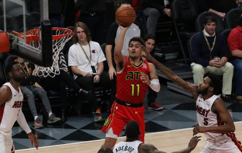 Rookie guard Trae Young shoots a floater against the Miami Heat. Young is leading Atlanta through their rebuild, as they prepare for a future that could be brighter than most think.