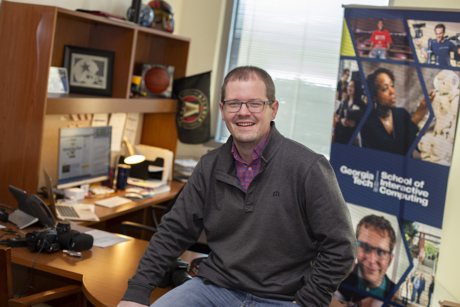 Former Panther David Mitchell sits in his office at Georgia Tech's School of Interactive Computing. After graduating from the Mill in 2006, Mitchell went from writing to sports for local newspapers to working in public relations and promotions at Tech.