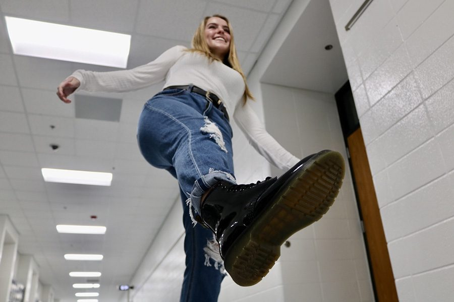 Senior Rose Stephens showcases her Doc Martens. Doc Martens became popular in the '90s and were worn mainly with leggings and a skirt or shorts.