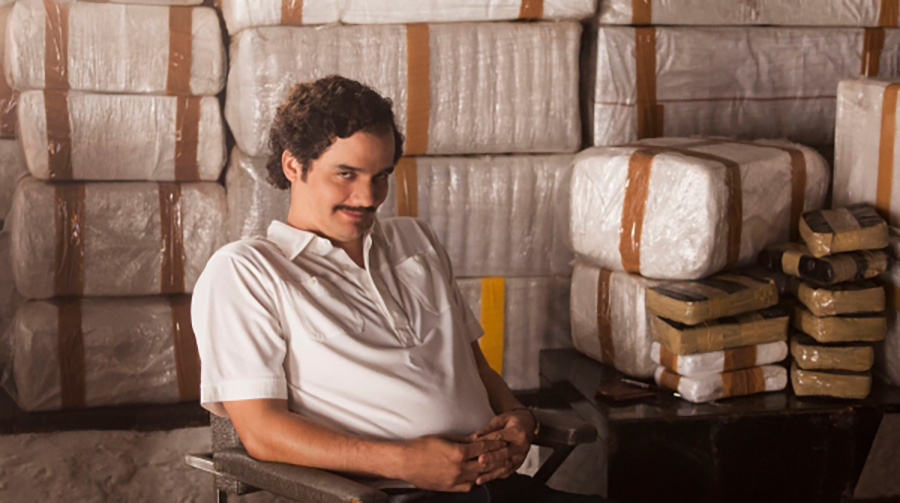 """Narcos"" character Pablo Escobar (Wagner Moura) stands in front of the product that gave him such tremendous power. He needs to be remembered for being the malicious, cruel killer that he is, not for the riches that he gained from his vile actions."