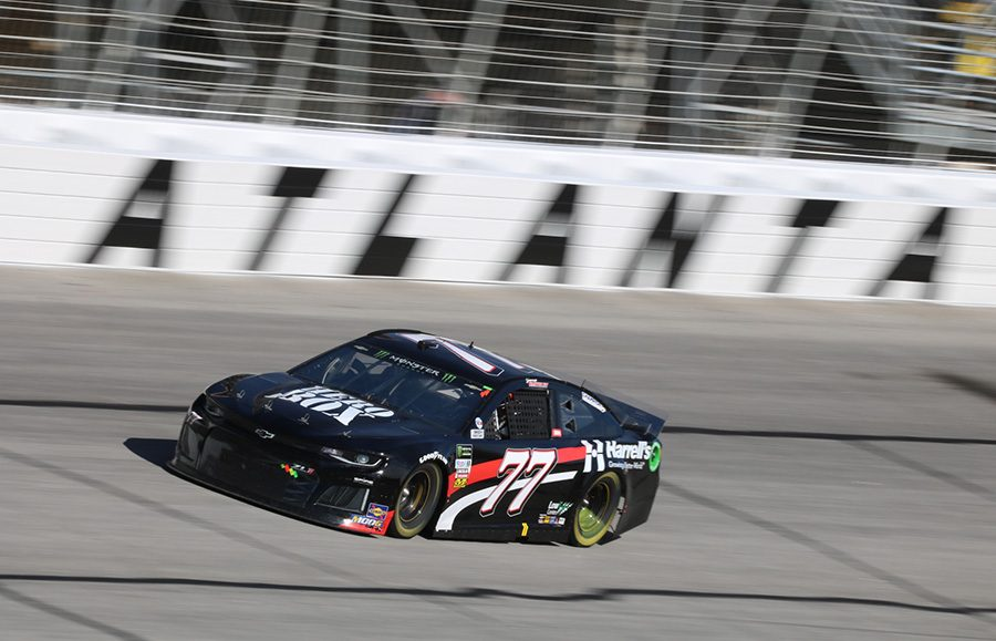 Georgia native Garrett Smithley, driver of the No. 77 Overkill Motorsports Chevrolet, passes the Atlanta writing in Turn 4. Smithley finished the race at his home track in 36th place and 71 laps behind race winner Brad Keselowski.