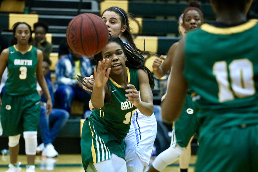 Griffin player passes to a teammate. Griffin defeated Starr's Mill 50-43 in the Region 3-AAAAA tournament championship. The win avenged their last-second loss to the Lady Panthers in the semifinals of last year's tournament.