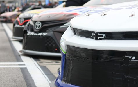 Monster Energy NASCAR Cup Series cars ined up on pit road prior to qualifying for the Folds of Honor QuikTrip 500.
