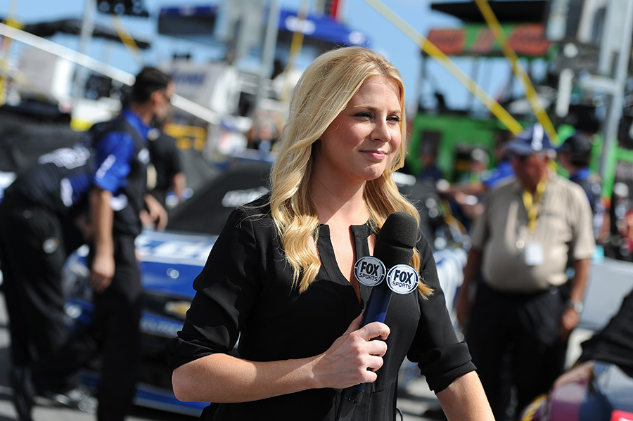 FOX Sports reporter Kaitlyn Vincie holds the microphone while reporting from pit road in 2015. Vincie embodies the idea of starting local and early. She started by uploading YouTube videos that she made at home covering races at Langley Speedway in Hampton, Virginia. The NASCAR fandom allowed for her to gain attention, and she caught the eye of FOX Sports.