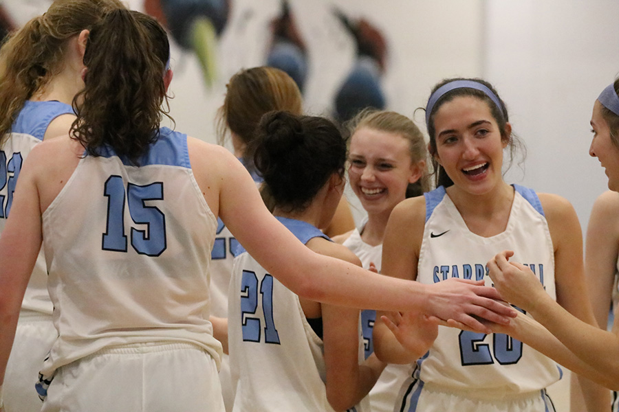Junior Alice Anne Hudson high fives her teammates after their win over Ware County. Hudson scored 23 points and snagged seven steals in the 58-44 win. This is only the second time in school history a girls' basketball team has advanced to the second round of the state playoffs.
