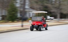 "Golf cart drives around Peachtree City transporting a person in their daily routine. While ""The Bubble"" isn't exactly the most industrial city, according to Expedia it is ranked the number one city to travel to in 2019."