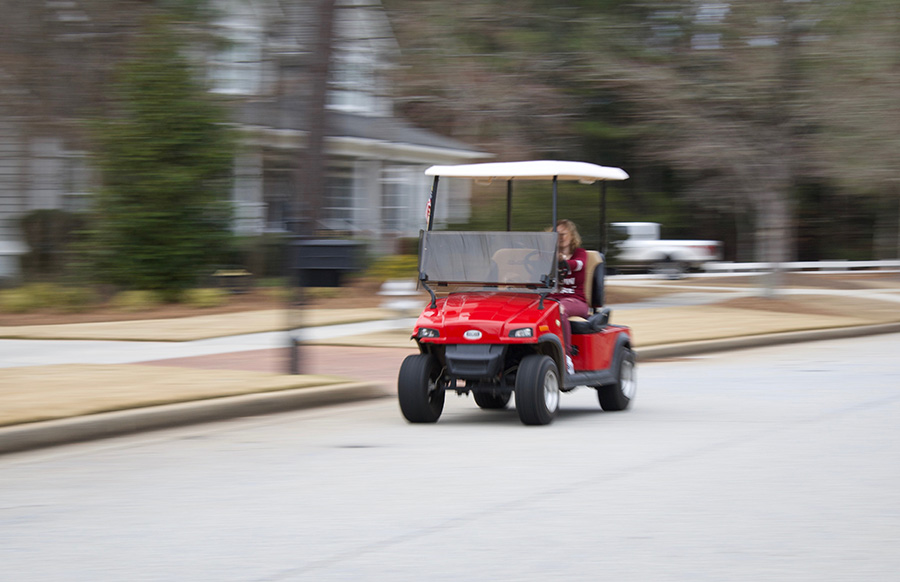"""Golf cart drives around Peachtree City transporting a person in their daily routine. While """"The Bubble"""" isn't exactly the most industrial city, according to Expedia it is ranked the number one city to travel to in 2019."""