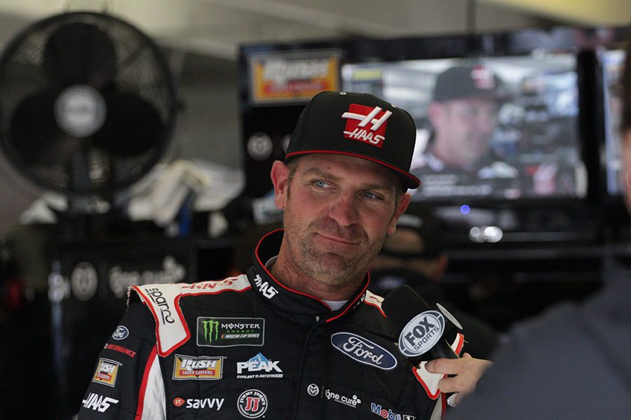 Clint Bowyer, driver of No. 14  Haas Automation Ford for Stewart Haas Racing, talks with FOX Sports in the garage. Bowyer paced the final Monster Energy NASCAR Cup Series practice with a speed of 179.104 mph. Bowyer also led the first practice and qualified third for the race.