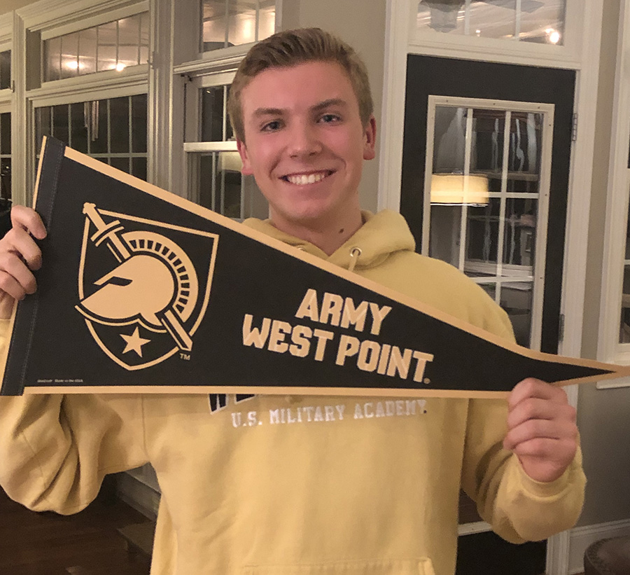 Rhett Perry holds up his West Point flag moments after receiving the news of his acceptance. Perry received a personal call from senator David Perdue to let him know that he got in.