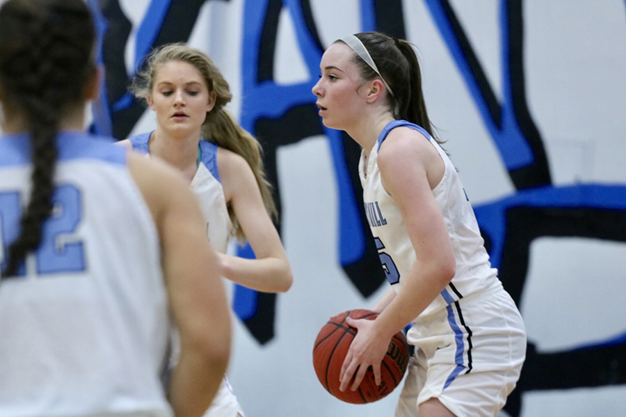 Junior Alice Anne Hudson scans the court for an open teammate. Hudson, a first team All-Region selection, senior Alyssa Angelo, and Region 3-AAAAA freshman of the year Jaclyn Hester have helped rebuild a girls' basketball program that missed the state playoffs just two years ago.