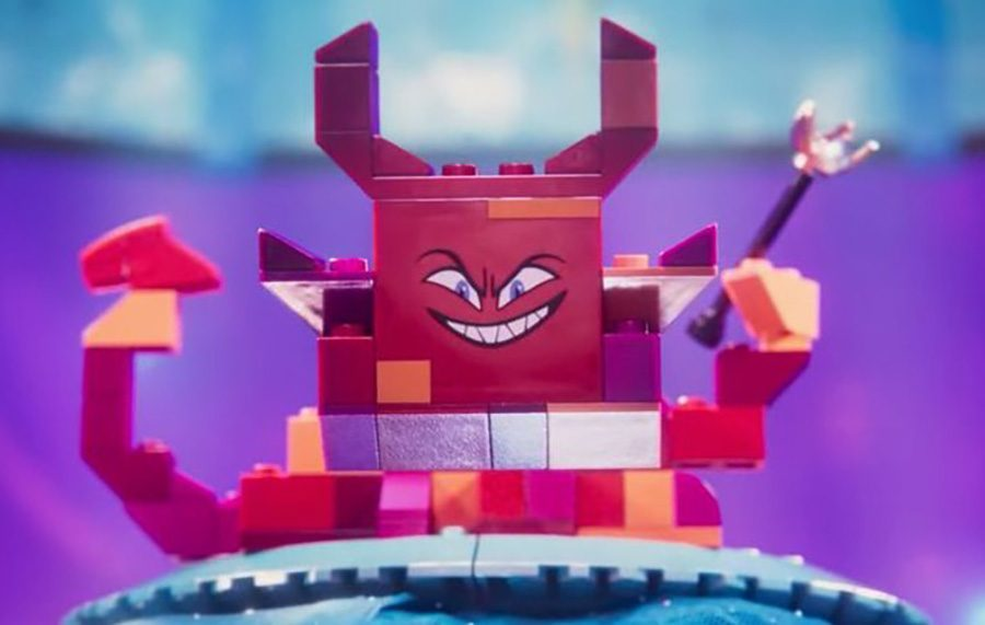 """Queen Whatevra Wa'Nabi reveals her monstrous form after kidnapping Wyldstyle and Batman. This new character represents the real-world little sister of the son in """"The Lego Movie."""""""