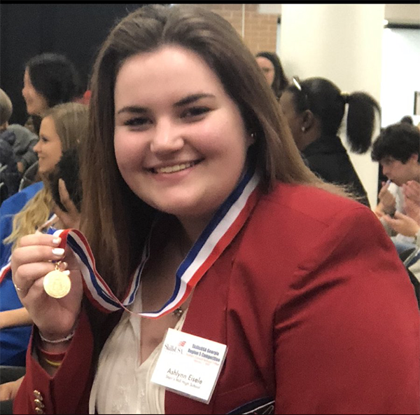 Junior Ashlynn Eisele received a medal for placing first at the SkillsUSA region five competition for medical assisting. SkillsUSA students will compete at the state competition from March 21-23.