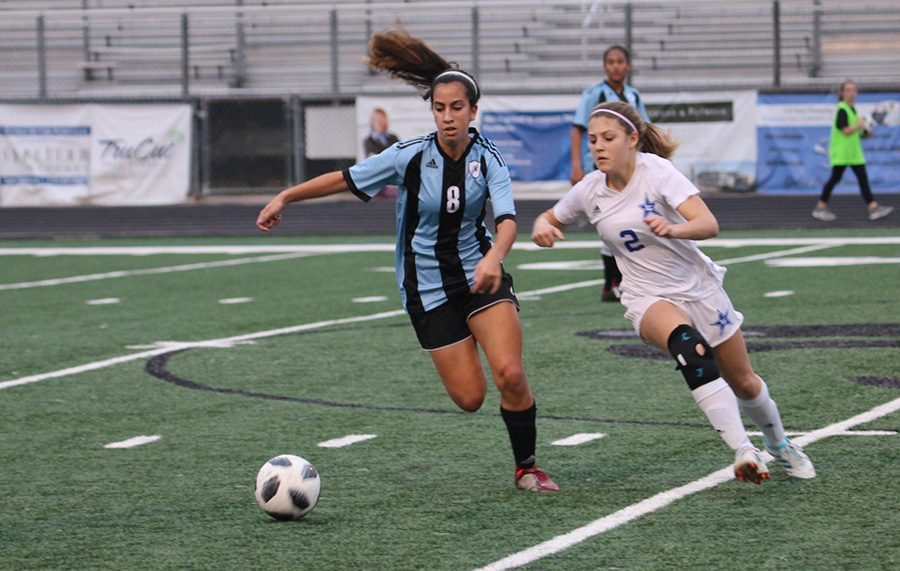Sophomore Sofia Varmeziar chases a ball while Granger sophomore Malone Aldridge attempts to keep up. Varmeziar scored one goal, and she was a large contribution to the offense, making skilled passes that helped move the ball around the field.
