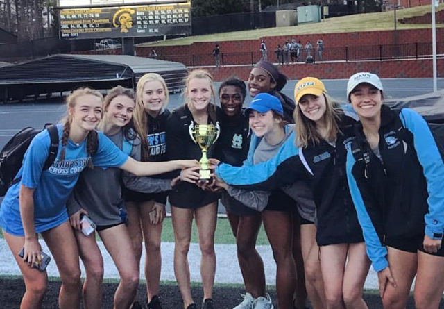 Members of the varsity girls' track and field team pose with their trophy. At the Carrollton Invitational, the girls finished in 2nd place overall behind Central Phenix City. The boys' team finished 10th overall at the event.