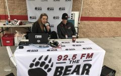 Panther alumna, Stephanie Johnson, sits down to talk with NASCAR Xfinity Series driver, Brandon Brown, in the 92.5 The Bear booth during race weekend at Atlanta Motor Speedway. Growing up a NASCAR fan, Johnson now records race recaps for the local radio station.