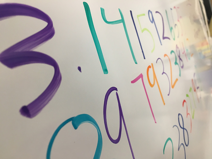 The number being expressed on the board is Pi, one of the most useful real numbers in math, specifically trigonometry. Because the Math team competition was on Pi Day, there was a scavenger hunt that helped boosting their morale and drive for math.