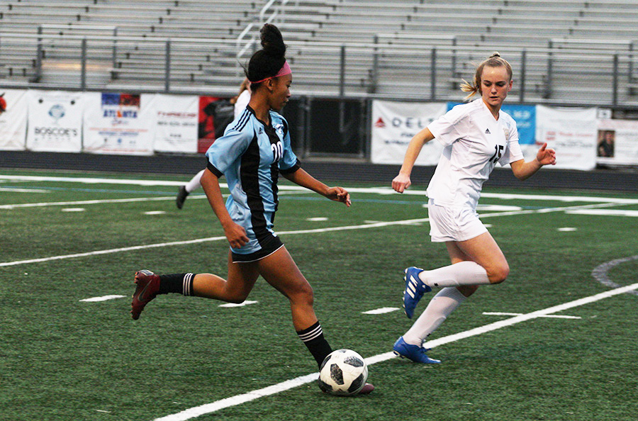 Sophomore Sara Evans dribbles the ball toward the goal. Evans had one goal and one assist in the game against Whitewater. The Lady Panthers shut out the Wildcats 4-0 improving their region record to 2-0.