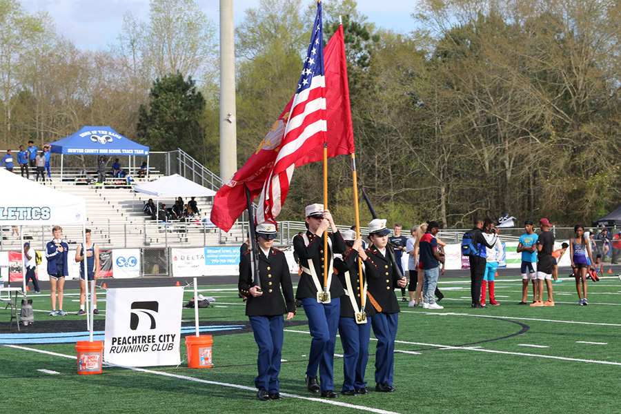 Students+in+the+Fayette+County+High+School+ROTC+program+hold+the+flags+for+military+appreciation.+The+night+began+in+the+spirit+of+military+appreciation%2C+as+twelve+aircrafts+flew+over+Panther+Stadium.
