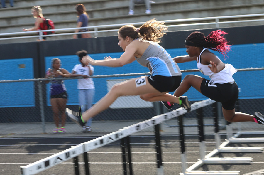 Freshman+Annaston+Evers+jumps+over+a+hurdle+in+the+100-meter+hurdle+event.+She+ran+a+time+of+18.81+seconds.